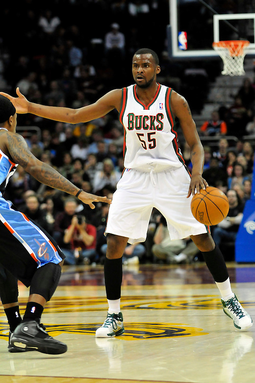 Jan. 21, 2011; Cleveland, OH, USA; Milwaukee Bucks guard Keyon Dooling (55) looks for a pass during the third quarter against the Cleveland Cavaliers at Quicken Loans Arena. The Bucks beat the Cavaliers 102-88. Mandatory Credit: Jason Miller-US PRESSWIRE