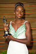 Lupita Nyong'o with the Oscar for Best Supporting Actress, at the Vanity Fair Osar party. Shot for The Guardian newspaper.