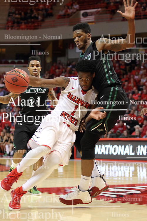 18 March 2015:  Paris Lee pushes into the lane against Alfonzo McKinnie  during an NIT men's basketball game between the Green Bay Phoenix and the Illinois State Redbirds at Redbird Arena in Normal Illinois