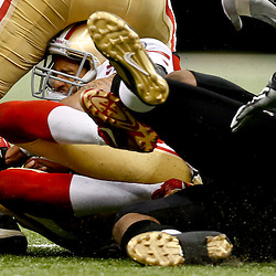 Nov 17, 2013; New Orleans, LA, USA; San Francisco 49ers quarterback Colin Kaepernick (7) is sacked by New Orleans Saints defensive end Cameron Jordan (94) during the second quarter of a game at Mercedes-Benz Superdome. Mandatory Credit: Derick E. Hingle-USA TODAY Sports