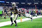 NEW ORLEANS, LA - SEPTEMBER 9:  Ted Ginn Jr. #19 of the New Orleans Saints catches a pass for a touchdown over Carlton Davis III #33 of the Tampa Bay Buccaneers at Mercedes-Benz Superdome on September 9, 2018 in New Orleans, Louisiana.  The Buccaneers defeated the Saints 48-40.  (Photo by Wesley Hitt/Getty Images) *** Local Caption *** Ted Ginn Jr.; Carlton Davis III