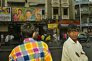 Men stand outside the Alfred Movie theater in Mumbai, December 8,2004. (Elizabeth Dalziel)