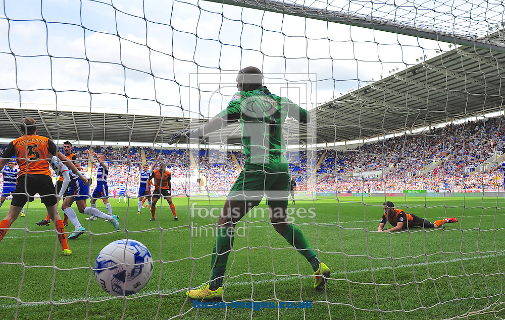 Michael Hector (left) of Reading heads the ball past goalkeeper Carl Ikeme of Wolverhampton Wanderers to score the opening goal during the Sky Bet Championship match at the Madejski Stadium, Reading<br /> Picture by Alan Stanford/Focus Images Ltd +44 7915 056117<br /> 28/09/2014