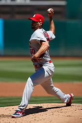 OAKLAND, CA - AUGUST 04:  Adam Wainwright #50 of the St. Louis Cardinals pitches against the Oakland Athletics during the first inning at the RingCentral Coliseum on August 4, 2019 in Oakland, California. The Oakland Athletics defeated the St. Louis Cardinals 4-2. (Photo by Jason O. Watson/Getty Images) *** Local Caption *** Adam Wainwright