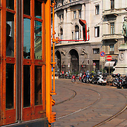 Trolley car and scooters, Milan, Italy