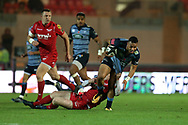Willis Halaholo of Cardiff Blues &reg; is stopped byRhys Patchell of the Scarlets (on ground). . Guinness Pro14 rugby match, Scarlets v Cardiff Blues  at the Parc y Scarlets in Llanelli, West Wales on Saturday 28th October 2017.<br /> pic by  Andrew Orchard, Andrew Orchard sports photography.