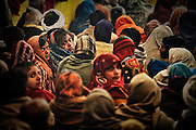 Young women in a theater tent in Kumbh Mela..Pilgrims after the holy bath can join shows in the tents.