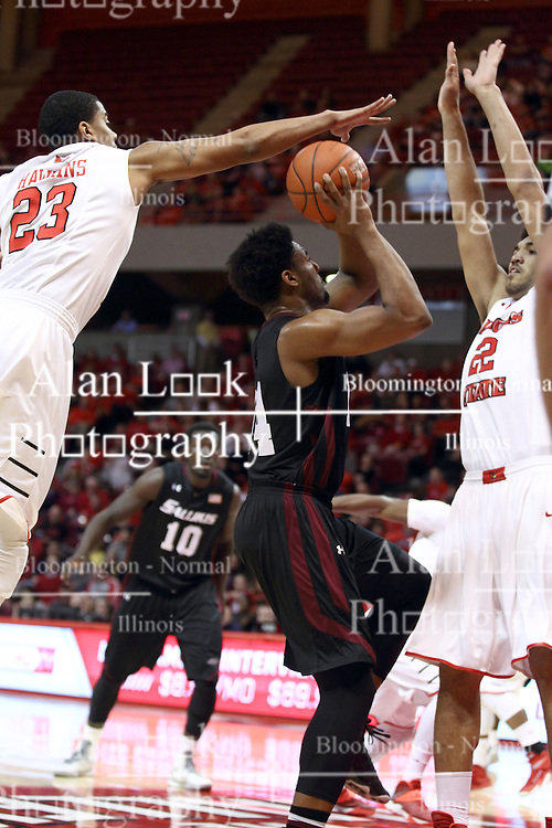 25 February 2015:   Jordan Caroline works to get off a shot while being doubled on by Deontae Hawkins and Reggie Lynch during an NCAA MVC (Missouri Valley Conference) men's basketball game between the Southern Illinois Salukis and the Illinois State Redbirds at Redbird Arena in Normal Illinois