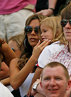 Photo: Glyn Thomas.<br />England v Paraguay. Group B, FIFA World Cup 2006. 10/06/2006.<br /> Victoria Beckham with child.