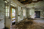 ABANDONED U.S. MARINE HOSPITAL<br /><br />The marine hospital opened in 1884 and consisted of six buildings – the surgeon's house, a stable, the executive building, two wards and the nurses' building. The facility was originally used to treat Civil War soldiers and to conduct scientific research in hopes of finding a cure for yellow fever.<br />During the 1930s, several new Works Progress Administration buildings were added to the site. To make room for the new buildings, the wards and stables were demolished and the executive and the nurses' buildings were moved three hundred feet to their current locations on wagons pulled by mules. The nurse's station is located on the east side of the 1930s hospital building and the executive building is now home to the National Ornamental Metal Museum, a museum for the collection, preservation, and exhibition of historical and contemporary metalwork.<br />The three-story, neo-classical brick hospital building was completed in 1937 and built in the Georgian-style with slate roofing, a copper cupola on pedestals, and large limestone columns, capitals, and gutters. Each wing of the building contained patient rooms and day rooms, while the center section contained a dental ward, operating room, sound proof chamber for hearing tests and nurse stations.<br />Although built to serve the needs of ailing seamen, the building has been used by the Coast Guard, cadets of the state maritime academies, members of the Coast and Geodetic Survey, Public Health fieldmen, the Army Corps of Engineers and employees and federal workers injured on duty.<br />After the hospital closed in 1965, the western half of the property was leased to a group of businessmen in 1976, who would later develop the Metal Museum. The buildings on that side of the property included a nurses' dormitory which now houses the museums galleries and gift shop, the junior officers' quarters which is used by artists in residence and other guests of the museum, and a two-story m