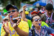 "09 MAY 2014 - BANGKOK, THAILAND: Thai anti-government protestors cheer for Suthep Thaugsuban in Lumpini Park Friday. Thousands of Thai anti-government protestors took to the streets of Bangkok Friday to start their ""final push"" to bring the popularly elected of government of Yingluck Shinawatra. Yingluck has already been forced out by a recent court ruling that forced her to resign and she is facing indictment by the National Anti Corruption Commission of Thailand for alleged improprieties related to a government rice price support scheme. The protestors Friday were marching to demand that she not be allowed to return to politics. The courts have not banned her party, Pheu Thai, which has formed an interim caretaker government to govern until elections expected in July, 2014. Suthep Thaugsuban, secretary-general of the People's Democratic Reform Committee (PDRC),  said the president of the Supreme Court and the new senate speaker, who would be selected Friday, should set up an ""interim people's government and legislative assembly."" He went onto say that if they didn't, he would.     PHOTO BY JACK KURTZ"