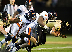 Virginia linebacker Clint Sintim (51) sacks Wake Forest quarterback Riley Skinner (11).  The Wake Forest Demon Deacons defeated the Virginia Cavaliers 24-17 in NCAA Division 1 Football at BB&T Field on the campus of Wake Forest University in Winston-Salem, North Carolina on November 8, 2008.