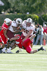 02 October 2010: Austin Davis and Josh Howe team up to stop Shariff Harris who is assisted by Matthew Van Dril during an NCAA football game where the Southern Illinois Salukis beat the Illinois State Redbirds 3817 at Hancock Stadium in Normal Illinois.