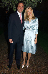 COUNT & COUNTESS ALLESANDRO GUERRINI-MARALDI at the annual Chelsea Flower Show dinner hosted by jewellers Cartier at the Chelsea Pysic Garden, London on 22nd May 2006.<br />