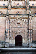 Low angle view of Ramos Door, New Cathedral, Salamanca, Spain, pictured on December 18, 2010 at midday. The 16th century Tympanum above the Palm Door is carved with a relief by Juan Rodriguez showing Jesus entering Jerusalem. Salamanca, Spain's most important University city,  has two adjoining Cathedrals, Old and New. The old Romanesque Cathedral was begun in the 12th century, and the new in the 16th century. Its style was designed to be Gothic rather than Renaissance in keeping with its older neighbour, but building continued over several centuries and a Baroque cupola was added in the 18th century. Restoration was necessary after the great Lisbon earthquake, 1755. Picture by Manuel Cohen