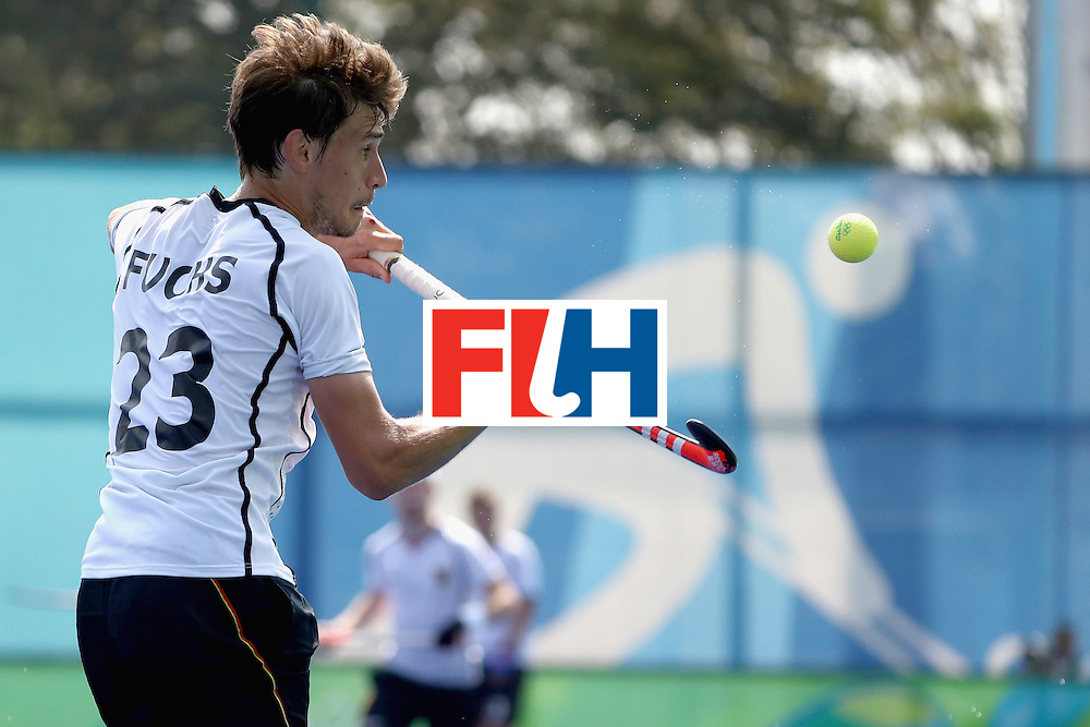 RIO DE JANEIRO, BRAZIL - AUGUST 18:  Florian Fuchs #23 of Germany hits a ball out of the air against Netherlands during the Men's Hockey Bronze  medal match at the Olympic Hockey Centre on Day 13 of the 2016 Rio Olympic Games on August 18, 2016 in Rio de Janeiro, Brazil.  (Photo by Sean M. Haffey/Getty Images)