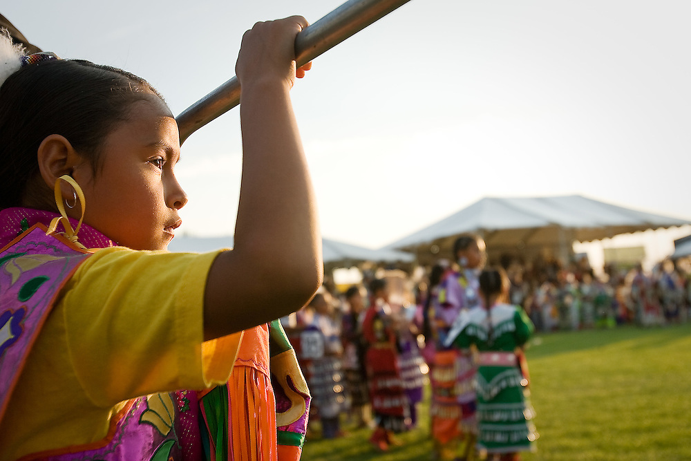 JEROME A. POLLOS/Press..Tommia Pakootas, a member of the Coeur d'Alene Tribe, watches as the dancers finish their grand entrance Friday at the 11th annual Julyamsh Powwow in Post Falls.