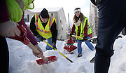 Members of Alpha Phi Omega help the Kent Fire Department clear snow from around the city's fire hydrants on Friday, Feb. 27, 2015. With the amount of snow Kent has received, many of the hydrants are buried and dangerously inaccessible. In the event of a fire, buried fire hydrants take time away from potentially saving lives because the firefighters have to spend time finding them and digging them out rather than tackling the fire.