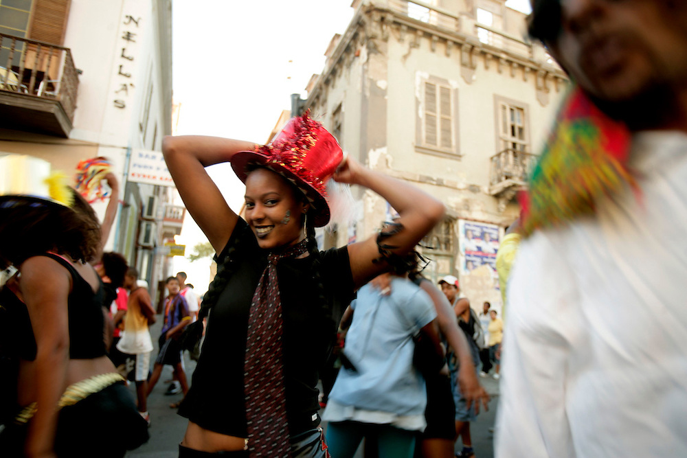 In Carnival Monday dozens of school girls and boys parade through Mindelo streets.