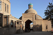 Low angle view of domed gateway, Tok-i-Sarrafon or Moneychangers' Bazaar, Bukhara, Uzbekistan, pictured on July 8, 2010 in the afternoon. The Tok-i-Sarrafon or Moneychangers' Bazaar, is one of the remaining domed Bazaars originating in the 16th-17th century trading boom along the Silk Road. Here Punjabi moneychangers would exchange Russian, Persian and Afghan currency into local coinage. Bukhara, a city on the Silk Route is about 2500 years old. Its long history is displayed both through the impressive monuments and the overall town planning and architecture. Picture by Manuel Cohen.