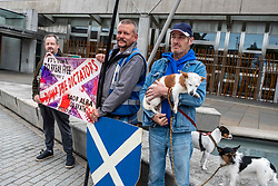 Pictured: Shaun Jones, Cliffe Serbie, Dean Halliday (Scottish) and his three dogs Fern, Saorsa and Indy<br /><br />There is a joke in here about two Englishmen, a Scotsman and three dogs…..<br />Shaun Jones, Cliffe Serbie, Dean Halliday (Scottish) and his three dogs Fern, Saorsa ands Indy were outside the Scottish Parliament to protest against the UK government in London. <br />Ger Harley | EEm 5 September 2019