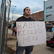 WASHINGTON, DC - MAR10: Robert Weiler Jr., 35, a fervent anti-abortion protester, in a portrait outside the construction site of the new Planned Parenthood which  is adjacent to the Two Rivers Public Charter School, March 10, 2016, in Washington, DC, as children walk home from school. The Two Rivers school is suing Weiler to prevent him from protesting outside the Planned Parenthood because it so close to the school.<br /> <br /> Weiler served five years in federal prison for planning to bomb another clinic. In 2006, authorities received information from Weiler&rsquo;s parents that they believed their son planned to destroy an abortion clinic. Weiler said he had intended to use a pipe bomb to blow up the abortion clinic in College Park. He also said he had planned tos hoot doctors who perform abortions. Since serving his prison sentence and probation, Weiler says he has protested at several places. (Photo by Evelyn Hockstein/For The Washington Post)