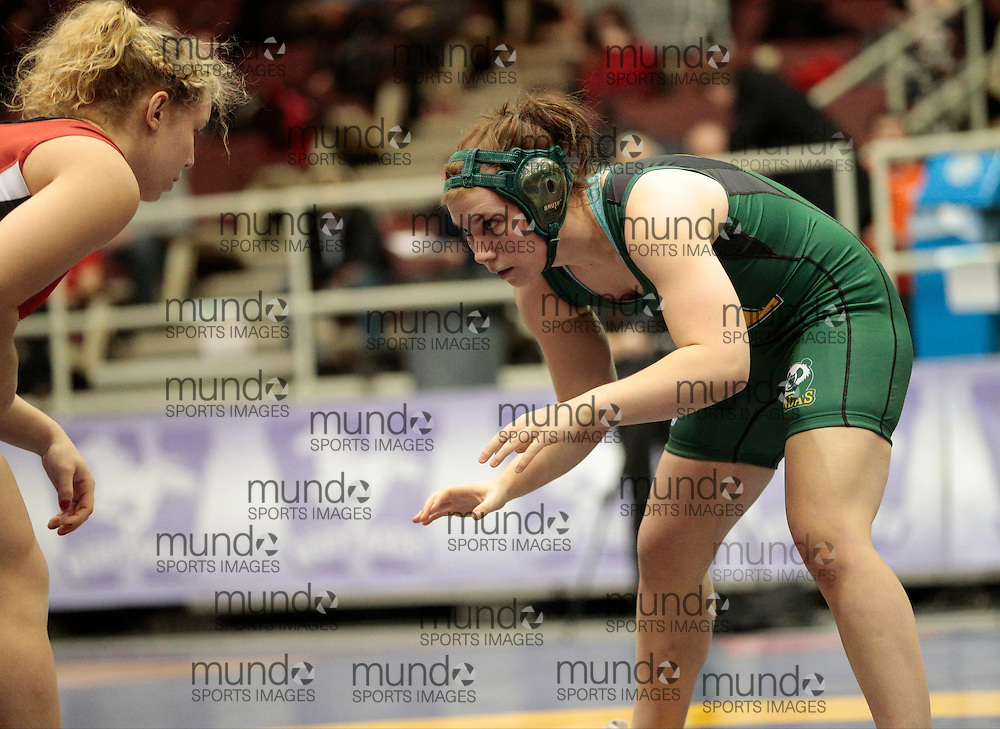 London, Ontario ---2013-03-02---  Molly Bouchard of  the University of Alberta takes on Rebecca Levitt of  Brock in the women's 72 kg gold medal match at the 2013 CIS Wrestling Championships in London, Ontario, March 02, 2013. .GEOFF ROBINS/Mundo Sport Images