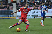 Oldham Athletic Defender, Cameron Dummigan looks to cross the ball during the Sky Bet League 1 match between Wigan Athletic and Oldham Athletic at the DW Stadium, Wigan, England on 13 February 2016. Photo by Mark Pollitt.