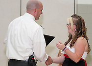 Jana Meeker (right) receives a certificate of completion from Principal Aaron Smith during the 8th grade recognition ceremony at Cleveland PK-8 School in Dayton, May 25, 2012.