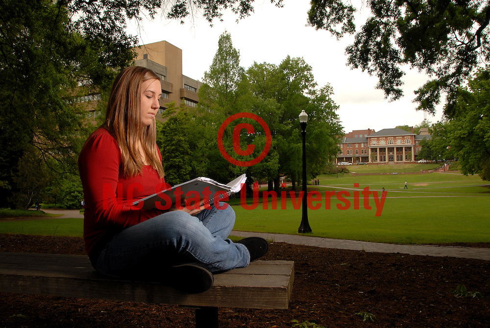 CHASS major Kelsey Romsoer sits in the Court of North Carolina and reads between classes. PHOTO BY ROGER WINSTEAD