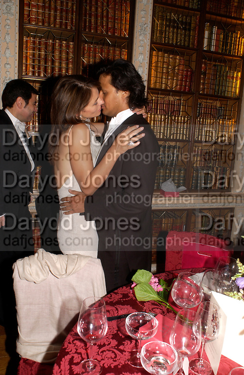 Elizabeth Hurley and arun Nayar, Ball at Blenheim Palace in aid of the Red Cross, Woodstock, 26 June 2004. SUPPLIED FOR ONE-TIME USE ONLY-DO NOT ARCHIVE. © Copyright Photograph by Dafydd Jones 66 Stockwell Park Rd. London SW9 0DA Tel 020 7733 0108 www.dafjones.com