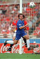 Gianfranco Zola (Chelsea) jumps with Dennis Irwin (Man Utd). Chelsea v Manchester United. FA Charity Shield. Wembley 13/8/00. Credit: Colorsport.