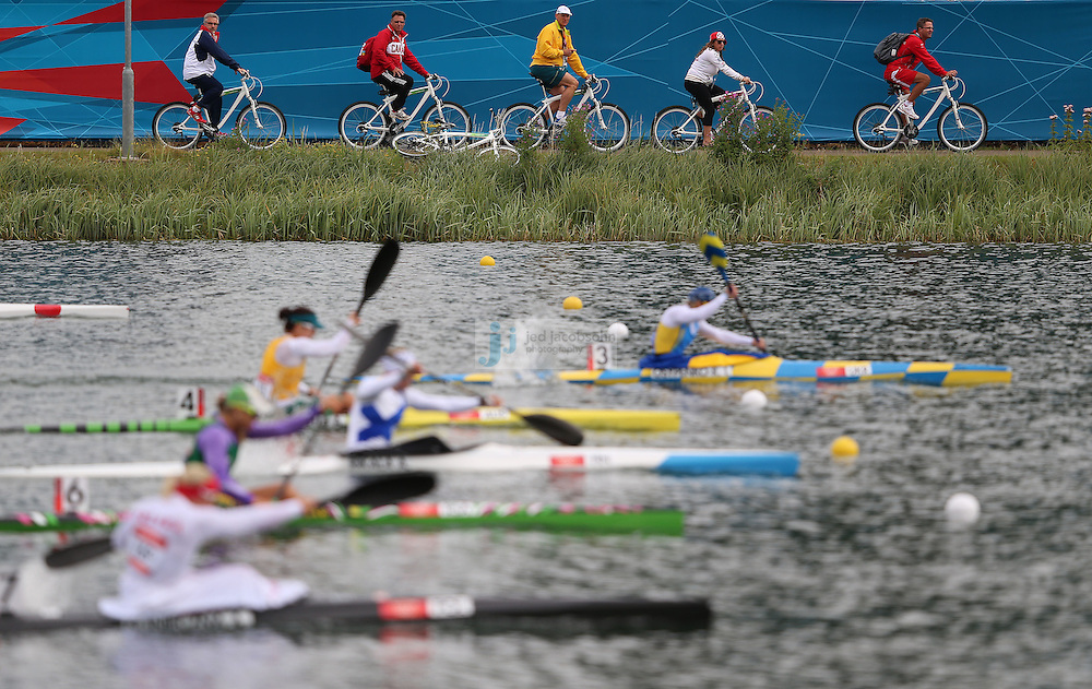 Coaches follow competitors on bicycles during the Women's Kayak Single (K1) 500m at Eton Dorney during day 11 of the London Olympic Games in London, England, United Kingdom on August 7, 2012..(Jed Jacobsohn/for The New York Times)..