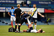 Cameron Brannagan (8) of Oxford United is treated for an injury as Jamie Mackie (19) of Oxford United chats to the referee during the EFL Sky Bet League 1 Play Off leg 1 of 2 match between Portsmouth and Oxford United at Fratton Park, Portsmouth, England on 3 July 2020.