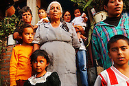 The Solano's deep sense of love and respect hold the large family together, as they gather infront their home in the small Mexican village of Cortijo Nuevo, Friday, May 16, 2003.  Many Mexicans feel forced to enter the U.S., looking for work, including a growing number in the housing industry.  (Roberto Gonzalez)