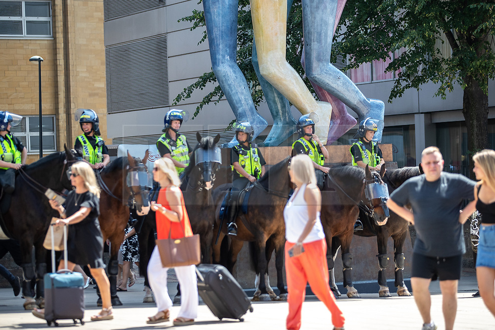 "© Licensed to London News Pictures . 07/07/2018 . Leeds , UK . Mounted police at an anti-Islam demonstration by supporters of jailed EDL founder Tommy Robinson , including those from the "" Yorkshire Patriots "" and "" First for Britain "" , in Leeds City Centre , opposed by anti-fascists . Robinson ( real name Stephen Yaxley-Lennon ) was convicted of Contempt of Court in May 2018 after committing a second offence , whilst serving a suspended sentence for the same crime . Photo credit : Joel Goodman/LNP"