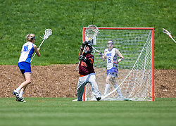 Virginia Tech Hokies GK Kari Morrison (0) saves a Duke Blue Devils M/A Lindsay Gilbride (18) shot.  The #3 seeded Duke Blue Devils defeated the #6 seeded Virginia Tech Hokies 19-6 in the first round of the 2008 Women's ACC Lacrosse Tournament held at the University of Virginia's Scott Stadium in Charlottesville, VA on April 24, 2008.