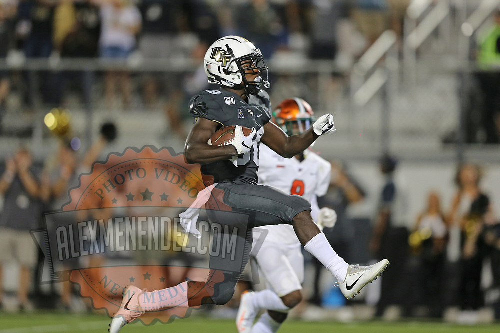 ORLANDO, FL - AUGUST 29: Greg McCrae #30 of the UCF Knights leaps into the end zone for a score during a NCAA football game between the Florida A&M Rattlers and the UCF Knights on August 29 2019 in Orlando, Florida. (Photo by Alex Menendez/Getty Images) *** Local Caption *** Greg McCrae