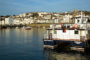Herm Trident Travel ferry in the harbour and the town of St Peter Port, Guernsey, Channel Islands, UK