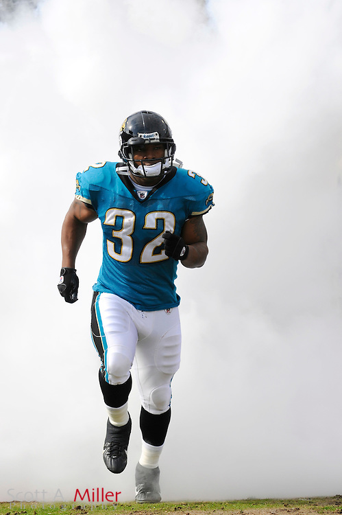 Dec. 14, 2008; Orlando, FL, USA; Jacksonville Jaguars running back Maurice Jones-Drew (32) during introductions prior to the Jags game against the Green Bay Packers at Jacksonville Municipal Stadium. Mandatory Credit: Scott A. Miller-US PRESSWIRE...©2008 Scott A. Miller