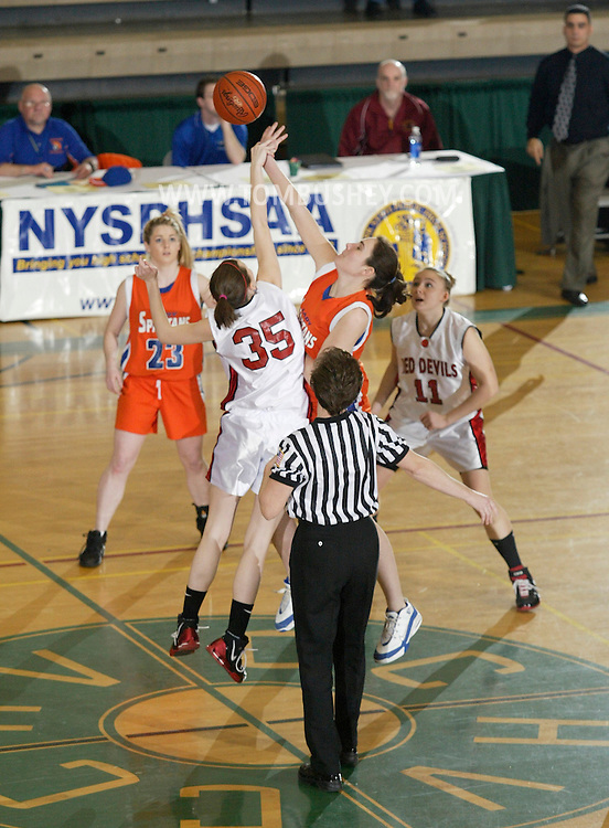 S.S. Seward's Kathleen Folkl and Hammond's Aubrie Dunn jump for the ball at the start of the Class D state championship game at Hudson Valley Community College in Troy on March 18, 2007.