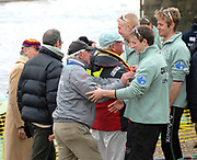 Putney, London,  Centre Left (grey jacket), Chief Coach, Chris NILSSON, CUBC Coach, Donald LEGGETT, congratulate members of Goldie crew, 156th University Boat Race, River Thames, between Putney and Chiswick, on the Championship Course.  Saturday  03/04/2010 [Mandatory Credit Karon Phillips/Intersport Images]