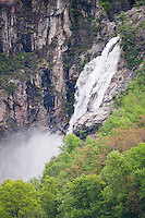 Ticino, Southern Switzerland. Beautiful waterfall in Maggia tumbling down the cliffs in a cloud of spray.