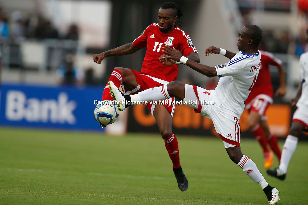 Javier angel Balbao of Equatorial Guinea (L) contests against Boris Tilton of Congo during AFCON opening ceremony match at the Estadio de Bata on January 17, 2014.Photo/Mohammed Amin/www.pic-centre.com (Equatorial Guinea)