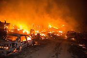 August 16, 2016 - California, U.S - Vehicles and structures burn off of Highway 138 as the Blue Cut Fire rages through San Bernardino County Tuesday August 16, 2016. The fire has scorched at least 18,000 acres and forced 82,000 people to evacuate their homes in San Bernardino County.<br /> ©Exclusivepix Media