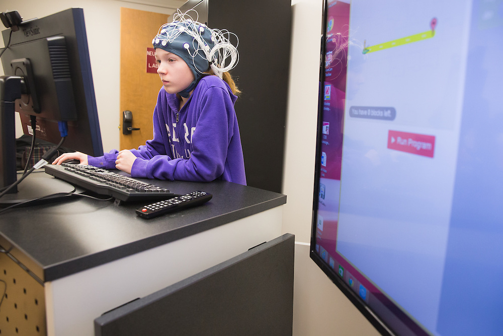 Alexis Grow, 12, a sixth-grade student at Sunnyside Elementary in Pullman, Wash., wears an EEG device which measures brain activity during a field trip to the Washington State University neurocognition sciene lab Monday, Feb. 22, 2016.