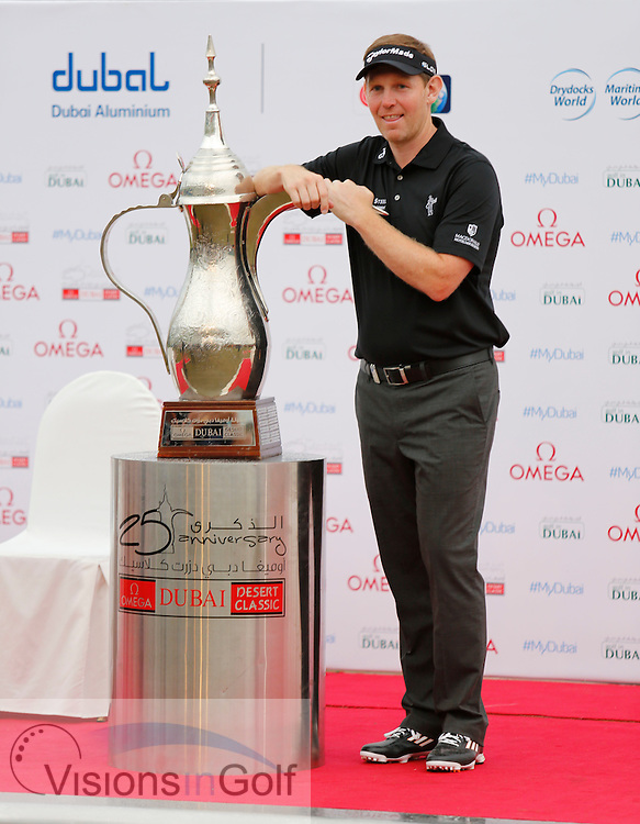 Stephen GALLACHER wins with the trophy <br /> Omega Dubai Desert Classic, Emirates GC, UAE, January 2014<br /> Picture Credit:  Mark Newcombe / www.visionsingolf.com