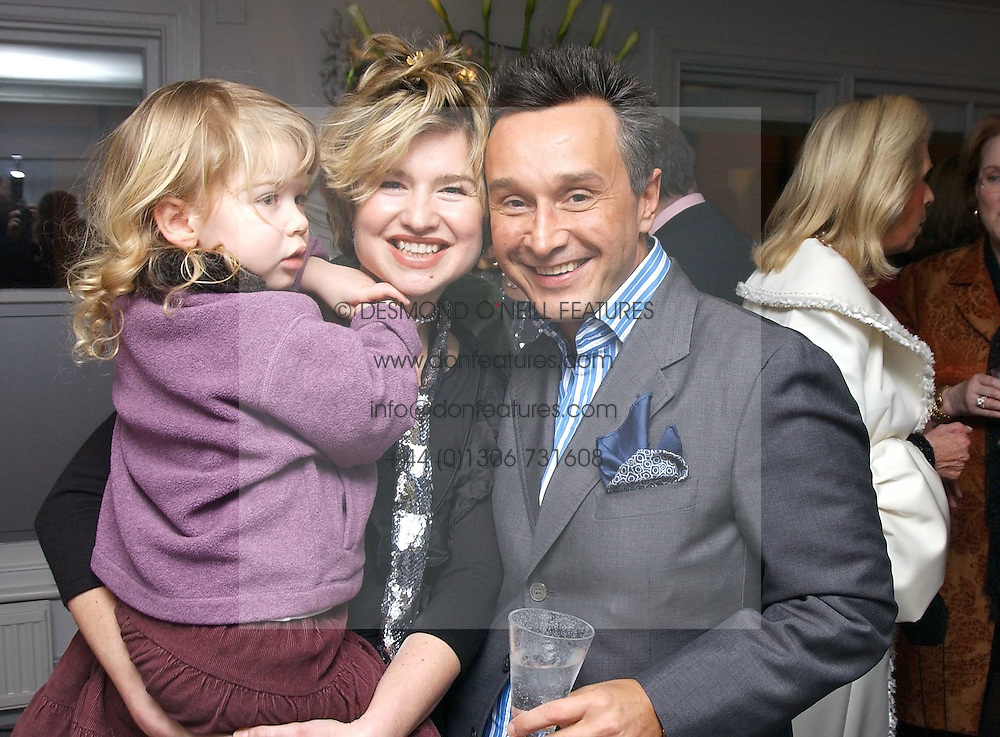 BARONESS ISSY VAN RANDWYCK, her daughter MISS GEORGIA HALL and TOMASZ STARZEWSKI at a party hosted American House and Garden magazine with Tomasz Starzewski and Nina Campbell to celebrate the British Issue of the magazine, held at 14 Stanhope Mews West, London SW7 on 13th March 2005.<br />