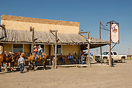 Jersey Lilly Saloon and Restaurant, Ingomar, Montana, young cowboys riding triple, ranch rodeo