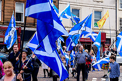 Lanark, Scotland, UK 20th August 2016   A march and ceremony to commemorate the death of Scottish Hero William Wallace (23rd August 1302) held on Saturday 20th August 2016.  Wallace has strong connections with the town of Lanark. Marchers carry Saltire flags.<br /> <br /> (c) Andrew Wilson | Edinburgh Elite media